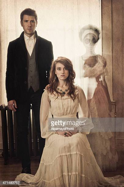 vintage portrait of a young couple with ghostly apparation (ii) - victorian style stock pictures, royalty-free photos & images
