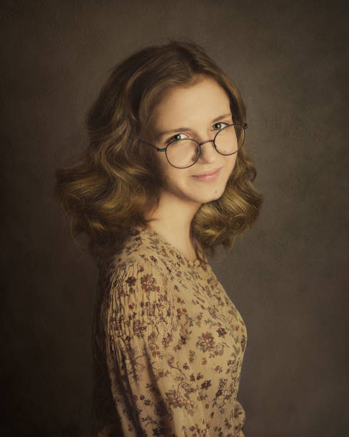 Vintage portrait of young woman in eyeglasses