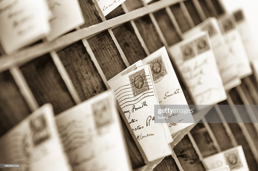 vintage post for delivery sorted into old style mail slots : Stock Photo