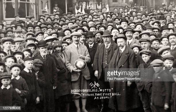 Vintage postcard featuring a crowd of people in Ashbourne, Derbyshire, during World War One commemorating the ancient Royal Shrovetide Football match...