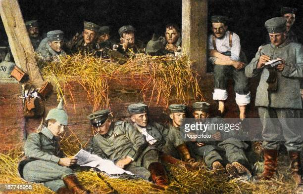 A vintage postcard featuring a group of German soldiers resting in a barn after a battle during World War One circa 1916