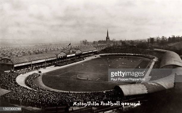 Vintage postcard featuring a huge crowd attending a football match at Villa Park, the home of Aston Villa in Birmingham, circa 1925.