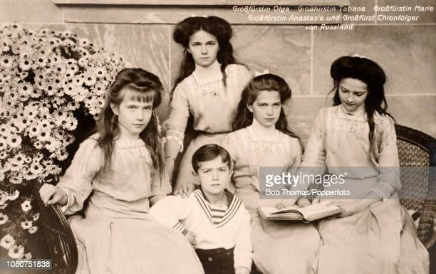A vintage postcard featuring a photograph of the five children of Czar Nikolas II of Russia left to right Grand Duchess Olga Grand Duchess Tatiana...