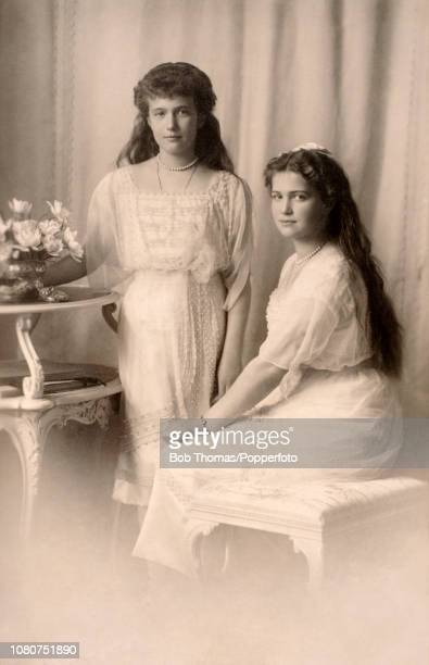 Vintage postcard featuring a photograph of two of the daughters of The Czar and Czarina of Russia: Grand Duchess Anastasia and Grand Duchess Marie,...