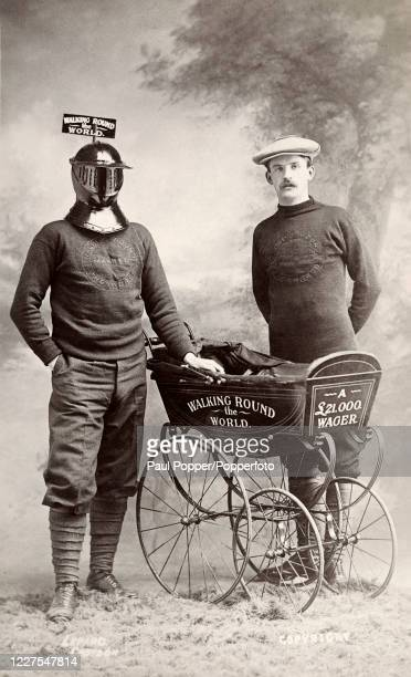 """Vintage postcard featuring adventurer Harry Bensley wearing an iron mask, with his chaperone, on his """"Walk around the World"""", which involved a..."""