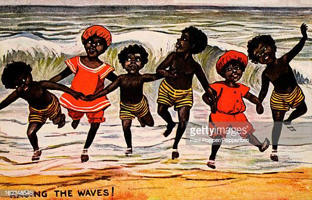Vintage postcard featuring an illustration of a group of black children playing in the sea, circa 1917.