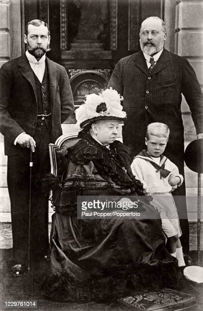 Vintage postcard featuring four generations of the British Royal Family, left to right, Prince George , Queen Victoria, The Prince of Wales and...
