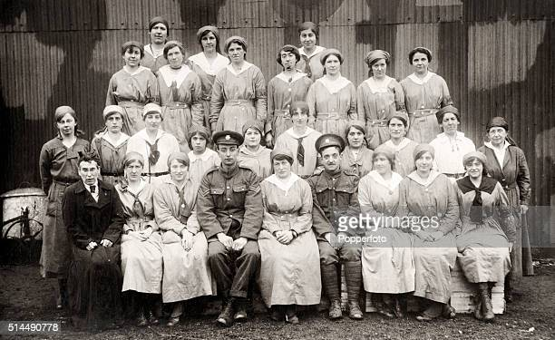 Vintage postcard featuring hospital staff including nurses, doctors and orderlies, during World War One, circa 1916.