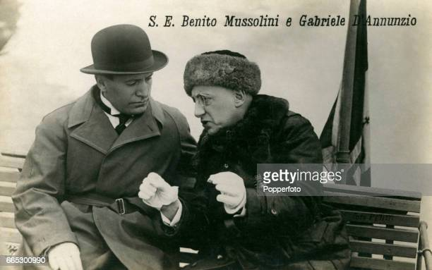 A vintage postcard featuring Prime Minister Benito Mussolini with poet and politician Gabriele D'Annunzio of Italy circa 1930