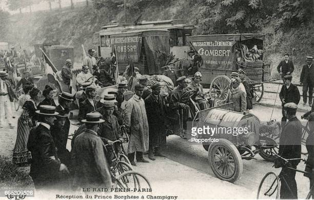 A vintage postcard featuring Prince Scipione Borghese of Italy at the wheel of his Itala during the Peking to Paris race at a reception in Champigny...