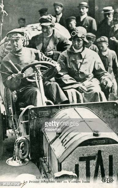 A vintage postcard featuring Prince Scipione Borghese of Italy in his Itala during the Peking to Paris race at a reception in Champigny circa August...