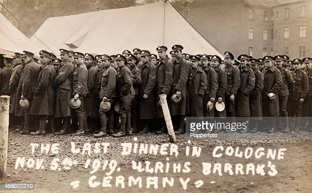 A vintage postcard featuring the 51st Battalion of the Manchester Regiment about to partake of the last dinner at their German barracks in Cologne...