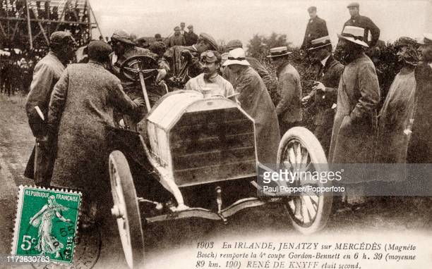 A vintage postcard featuring the Belgian racecar driver Camille Jenatzy beside his Mercedes winner of the Gordon Bennett Cup in Athy Ireland on 2nd...