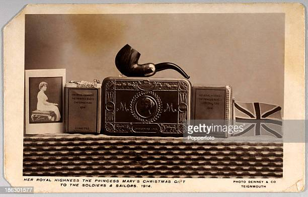 A vintage postcard featuring the Christmas gift tin and its contents which was given to all soldiers and sailors of the British Armed Forces in...