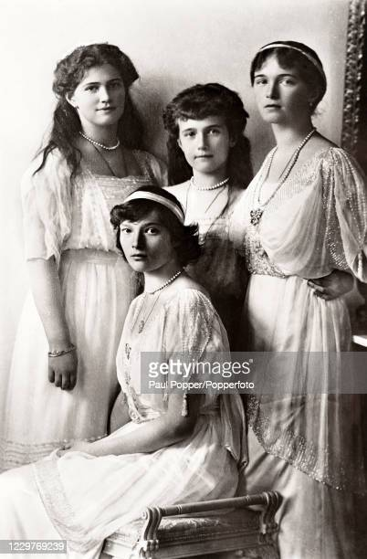 Vintage postcard featuring the four daughetrs of Tsar Nicholas II and Tsarina Alexandra of Russia, left to right, The Grand Duchesses Maria, Tatiana,...