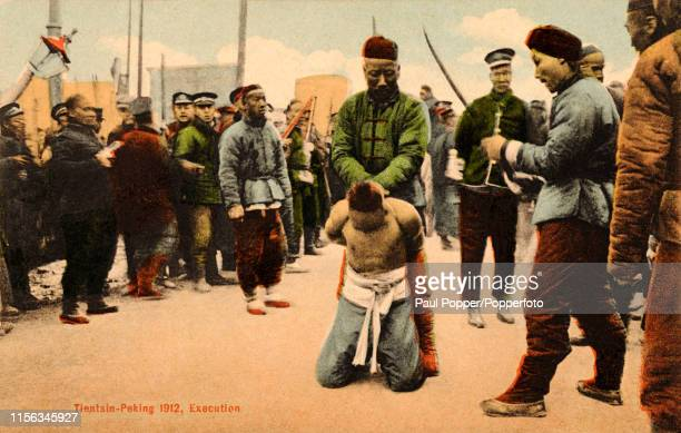A vintage postcard featuring the preparations for an execution in Peking China circa 1912