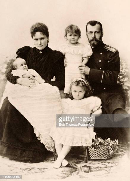 A vintage postcard featuring Tsar Nicholas II and Tsarina Alexandra of Russia with three of their daughters left to right Grand Duchess Maria Grand...