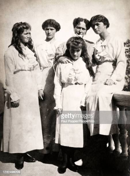 Vintage postcard featuring Tsarina Alexandra with her four daughters, the Grand Duchesses Maria, Olga, Tatiana and Anastasia, published in Paris,...