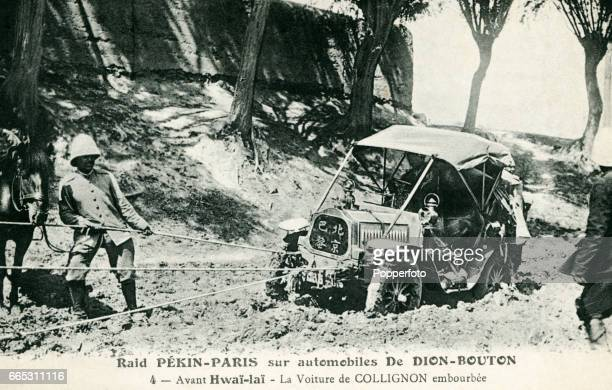 A vintage postcard featuring Victor Collignon of France at the wheel of his 10 horsepower De DionBouton being pulled out of the mud in the Gobi...