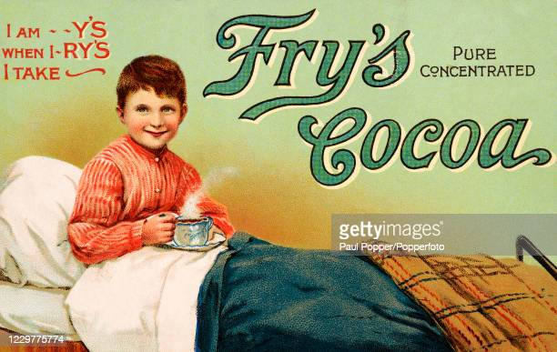 Vintage postcard illustration advertising Fry's pure concentrated cocoa, featuring a young boy in bed with a steaming cup of hot chocolate, published...