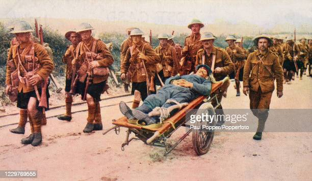 A vintage postcard illustration featuring a group of Gordon Highlanders conveying a wounded German soldier during World War One published in London...