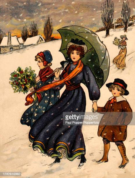 Vintage postcard illustration featuring a mother and her two children with an umbrella and an armful of holly in a snowy village landscape, published...