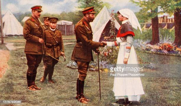 A vintage postcard illustration featuring King George V of Great Britain and Ireland meeting a hospital matron at the Front during World War One...