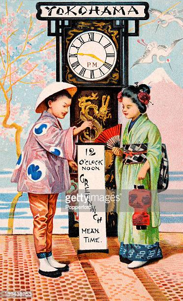 A vintage postcard illustration of a Japanese boy and girl in national dress illustrating the difference between Greenwich Mean Time and the time in...