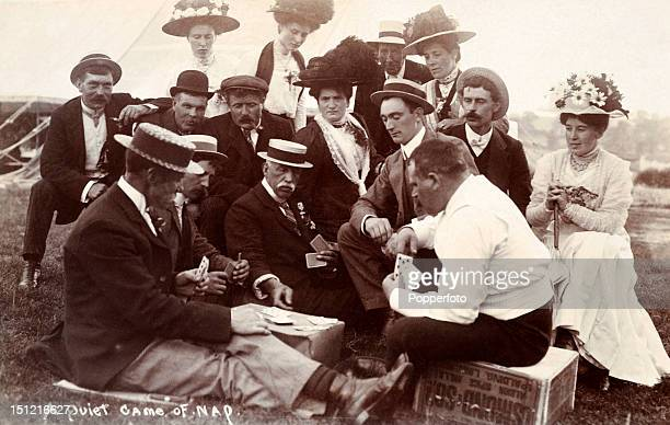 Vintage postcard of a group of people playing or watching the card game nap or Napoleon, circa 1910.