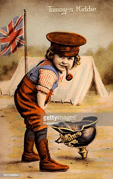 A vintage postcard published in France during World War One titled 'Tommy's Kiddie' featuring a little boy wearing a soldier's hat and smoking a pipe...