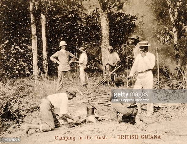 A vintage postcard showing a group of people camping in the Amazon Rainforest in British Guiana South America circa 1910 British Guiana became Guyana...