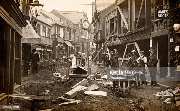 A vintage postcard showing the effects of subsidence due to salt mining in the northern England town of Northwich circa 1900 Repairs to the town's...
