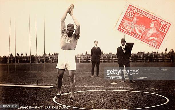 Vintage postcard with a 1924 Olympic Games postage stamp attached which features an athlete from Finland holding a discus circa July 1924 In the 1924...