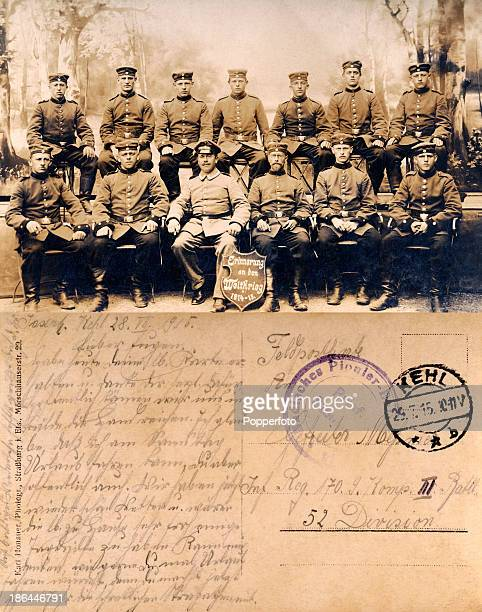 A vintage postcard with a message in German featuring a studio portrait of a group of German Army officers with a plaque titled In Remembrance of the...