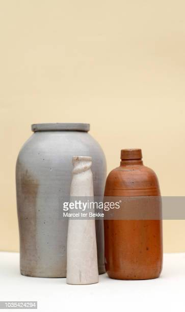vintage pottery collection in studio - vase stock pictures, royalty-free photos & images