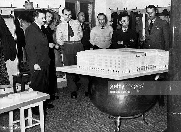 Hitler Adolf Politician NSDAP Germany watching an architectural model for the 'Haus des Deutschen Fremdenverkehrs' in Berlin from left Hitler...