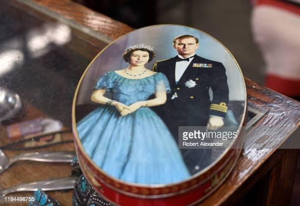 A vintage Queen Elizabeth II coronation souvenir a biscuit tin for sale at an antique shop in Santa Fe New Mexico
