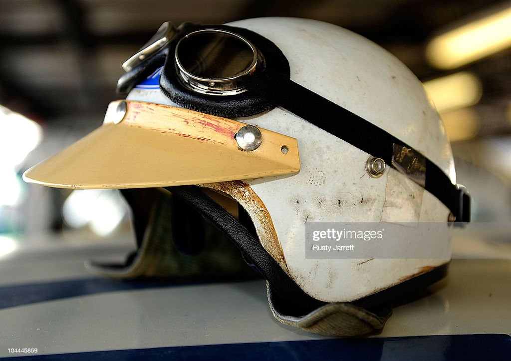 A Vintage Racing Helmet Sits On Top Of A Car In The Garage Area News Photo Getty Images