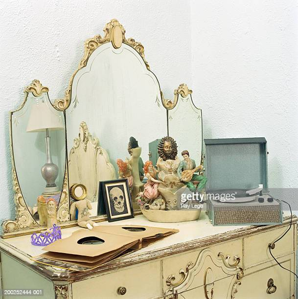 Vintage record player and records on vanity