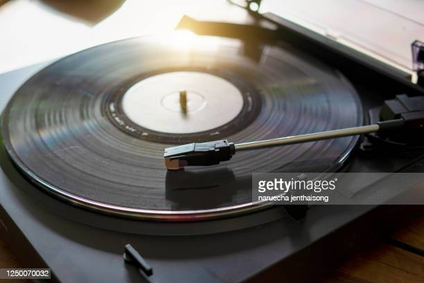 vintage record player with vinyl disc, close-up. ray from the sunset - record analog audio stock pictures, royalty-free photos & images