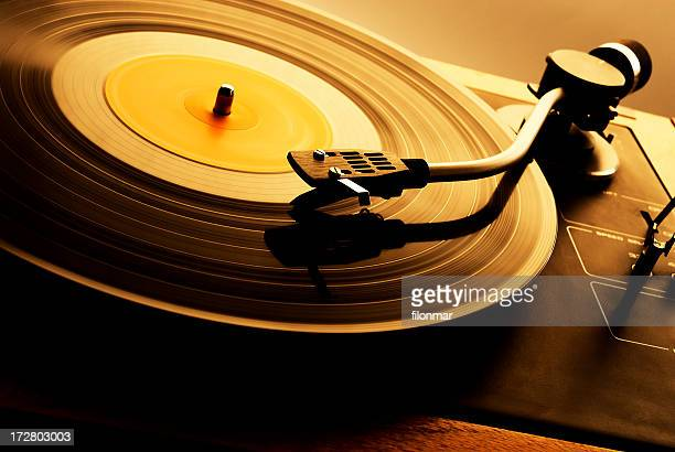 A vintage record spinning on a turntable