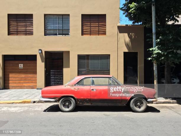 vintage red sports car parked in the street - obsolete stock pictures, royalty-free photos & images