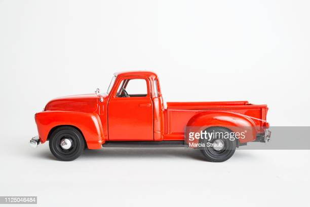vintage red truck on white background - old truck stock pictures, royalty-free photos & images