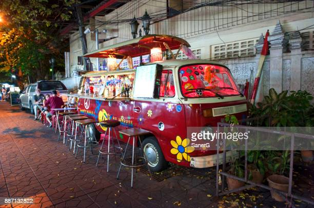 vintage red volkswagen bus - bar drink establishment stock photos and pictures