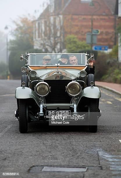 Vintage Rolls Royce driving through the village of Cuckfield