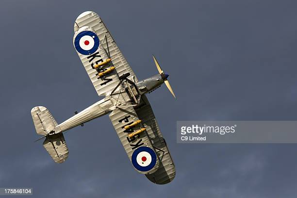 CONTENT] A vintage Royal Air Force Hawker Hind flying past at a display at the 'Shuttleworth Collection' in Bedfordshire