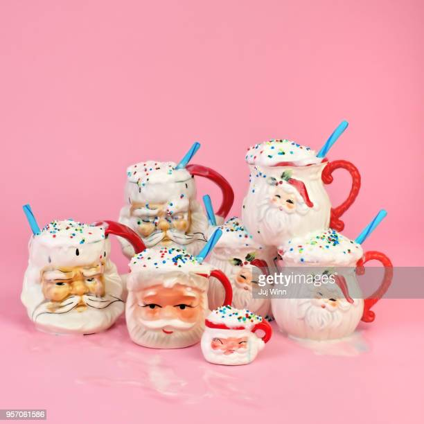 vintage santa mugs with cocoa - santa face stockfoto's en -beelden
