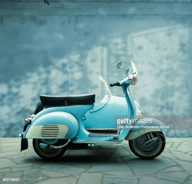 Vintage scooter parked on sidewalk