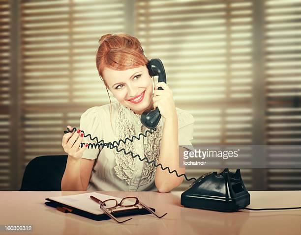 Vintage secretary flirting on the phone