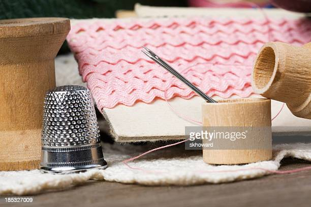 vintage sewing items - thimble stock photos and pictures